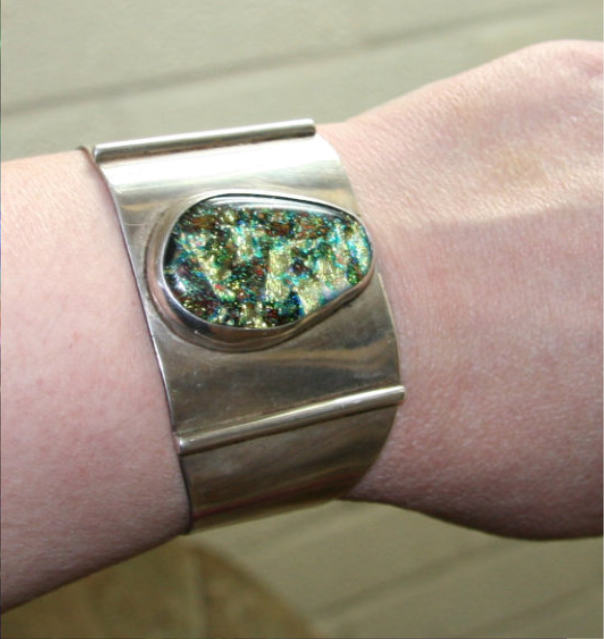 Bespoke Silver Cuff Bracelet with shimmering green dichroic cabochon
