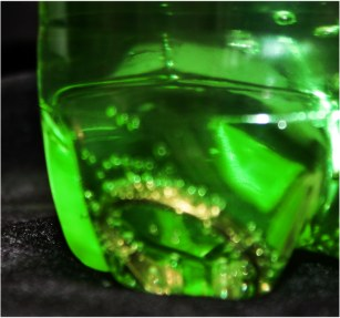 Money Magic Potion: Gold ring at the bottom of a bottle of mineral water
