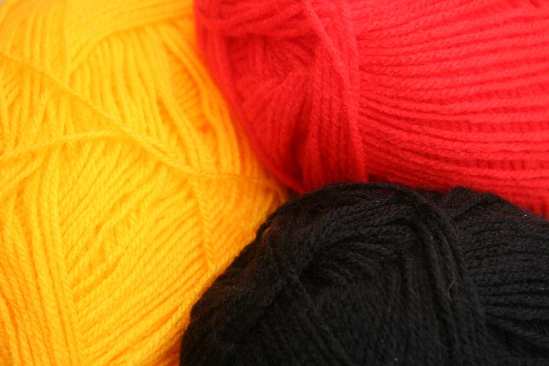 Red, gold and black wool picture